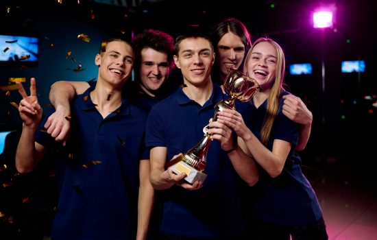 team-of-excited-teenage-participants-of-e-sports-video-gaming-competition.jpg